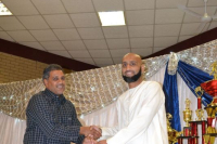 Mr Shaheen Asmal receives medals for Little League Teams