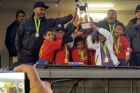 RFC Under 9 team raise their trophy
